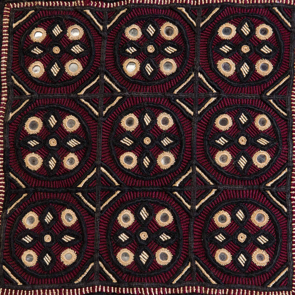 Jat embroidered cushion cover from the kachchh desert by maiwa, featuring black and burgundy hand embroidery on black linen