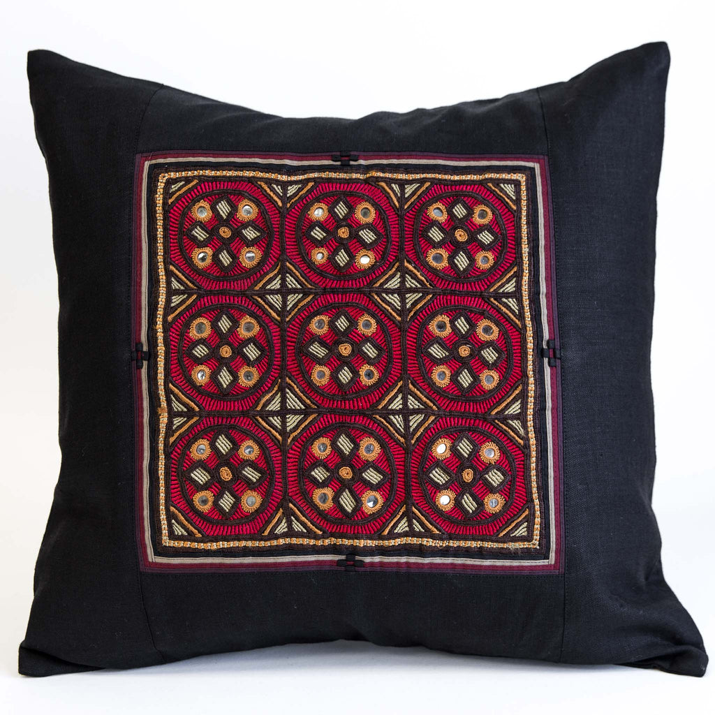 Jat embroidered cushion cover from the kachchh desert by maiwa, featuring red and gold hand embroidery on black linen