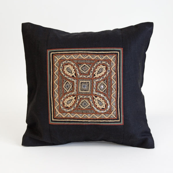 Rabari gold and brown Embroidered motif on natural linen cushion cover from kachchh with Maiwa