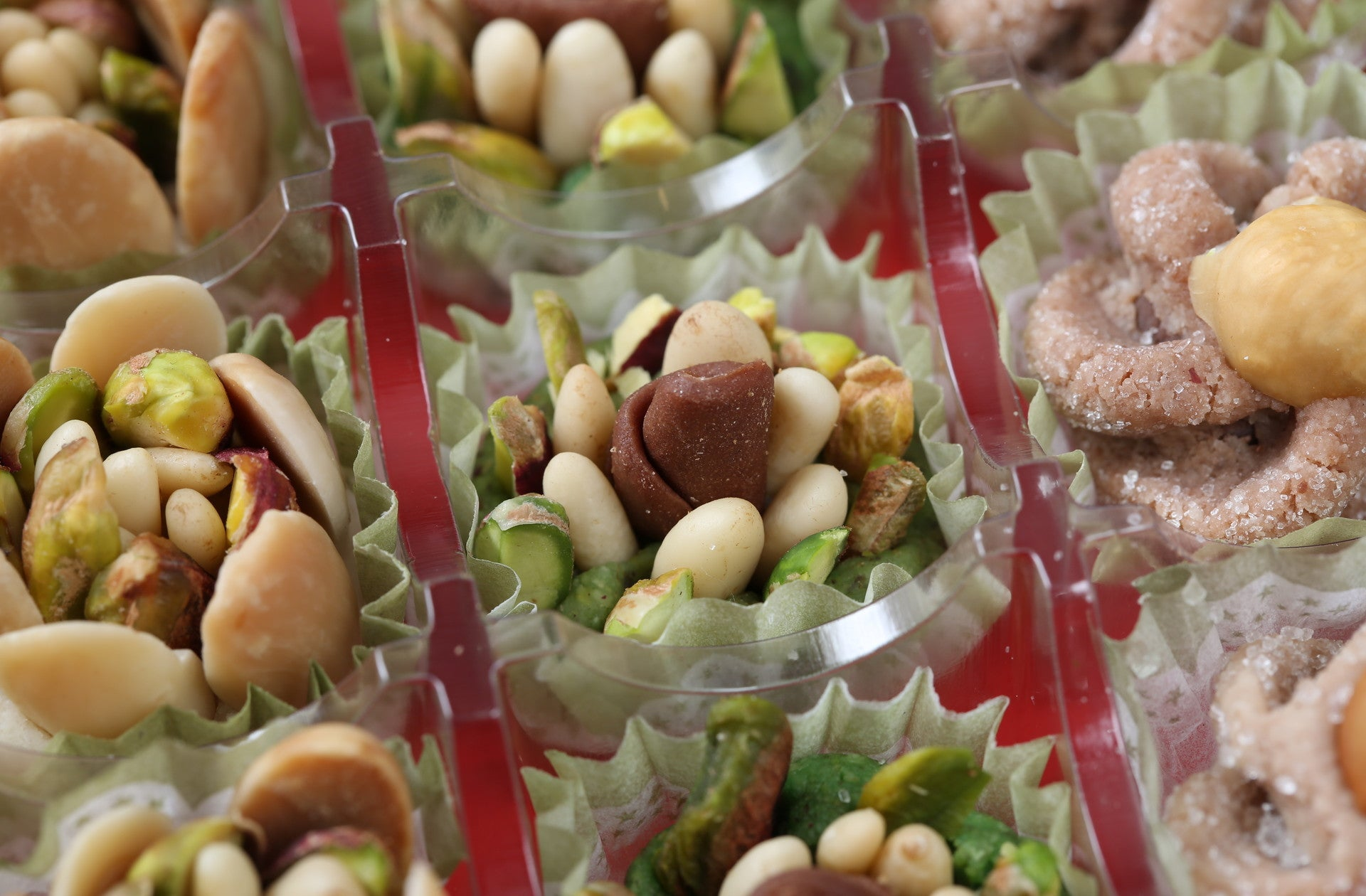 Our gourmet concoction of sugar and organic nuts come together for a luxurious and heavenly experience. Each handmade jewel is comprised of premium nuts blended to a standard of perfection, and adorned with an assortment of pistachios, pine nuts, hazelnuts, and almonds.