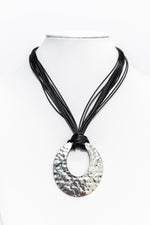 Silver Hammered Cut Out Oval Pendant On Layered Black Cord Necklace - NEK3277SI
