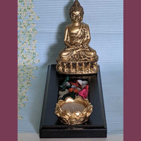Antique Buddha Statue On Wooden Tray With Deepa