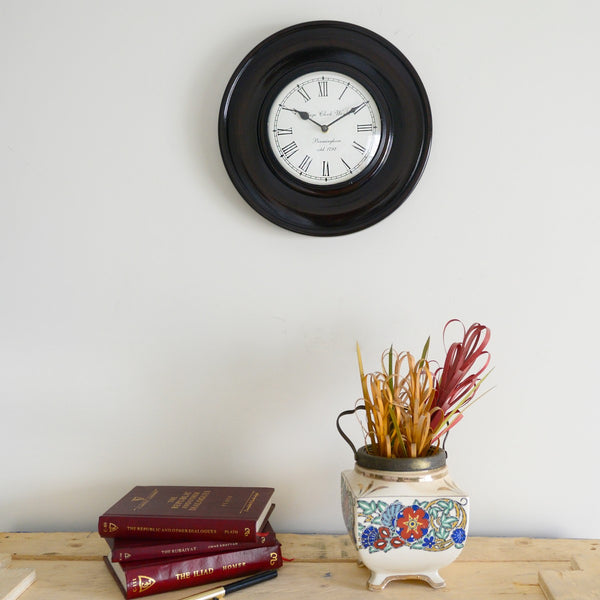 Black Polish Wall Clock at Qtrove