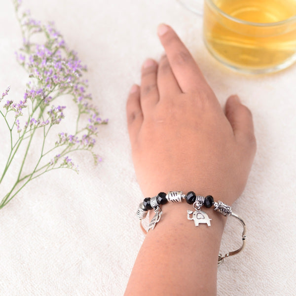 Handcrafted Charm Bracelet With Black and Silver Beads at Qtrove