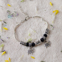 Handcrafted Charm Bracelet With Black and Silver Beads