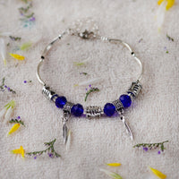 Handcrafted Charm Bracelet With Blue And Silver Beads