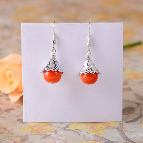 Handcrafted Metal Earring With An Orange Drop