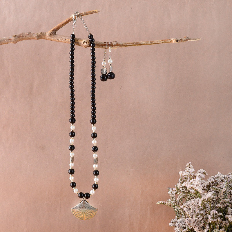 Handcrafted Black And Pearl Necklace With A Stylish Shell Pendant