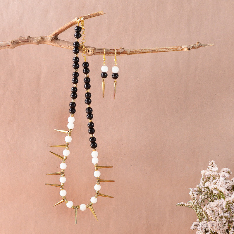 Handcrafted Black And Pearl Necklace With A Rustic Gold Spikes