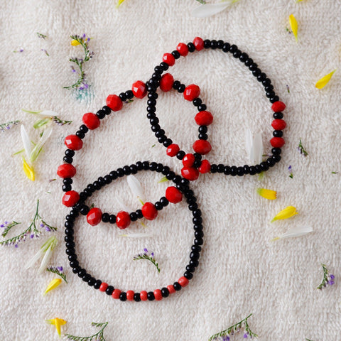 Set of Three Bracelets With Black And Red Beads