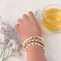 Set Of Three Bracelets With Golden And White Beads