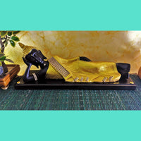 Reclining Buddha Statue on Wooden Platform