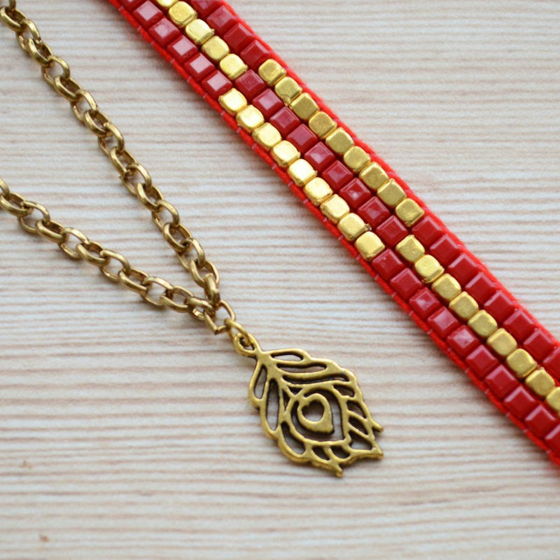 Red & Gold Rakhi With Peacock Feather Gold Bracelet