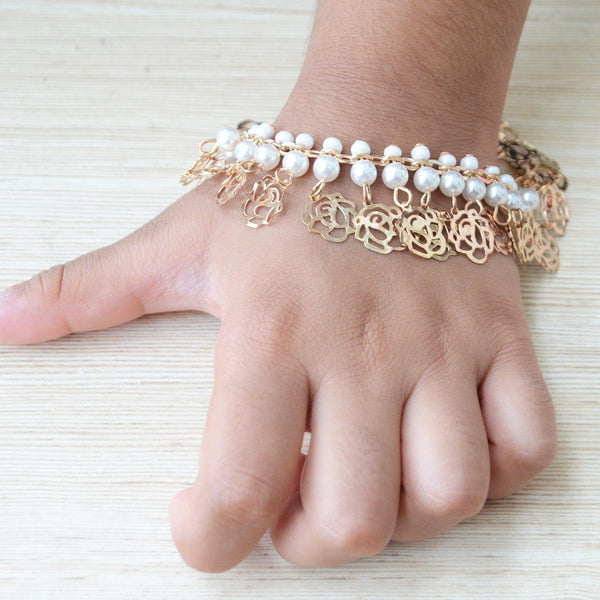 Rose Gold and Pearl Bracelet Rakhi at Qtrove