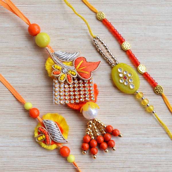 Yellow, Orange and Gold Kundan Bead Handcrafted Rakhi Including Lumba (Set of 4) at Qtrove