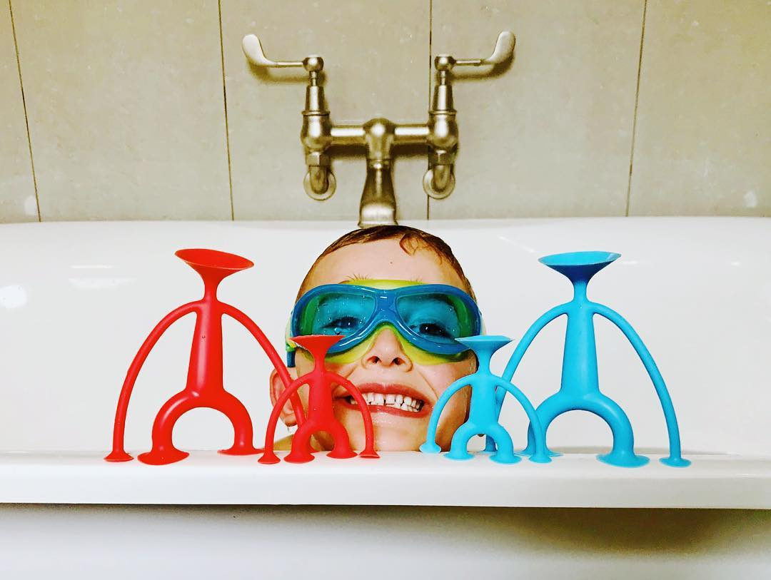 6 year old boy in goggles and the Oogi Family Toys