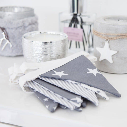 This beautiful handmade bunting, in 4 stylish grey and white fabrics, is a stunning way to give your home a lovely Christmassy feel.