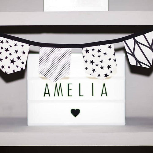This beautiful handmade bunting in 3 stylish Monochrome fabrics is perfect for a boy's or girl's nursery, bedroom or playroom.