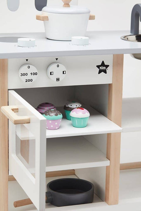 Lovingly hand crafted using the finest wood, this handmade wooden kitchen is a beautiful addition to any kids room.