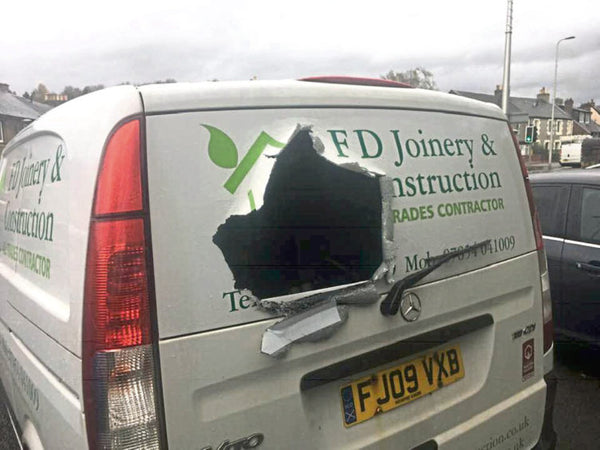 Thieves stole about £2,500 of equipment from a joiner's van after ripping a hole in the back of the vehicle.