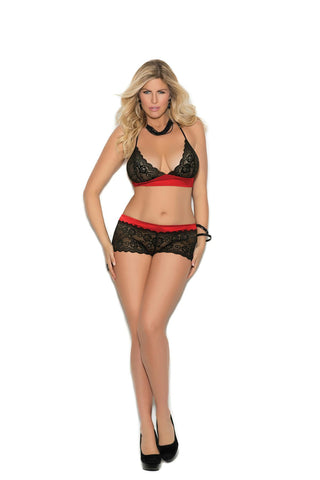 Cupless halter neck lace bra and matching crotchless panty with satin bows.