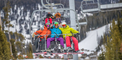 Riding a Chairlift with a Sno-Go Bike