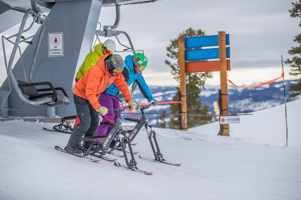 Sno-Go bikes on a chairlift