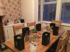 Gin tasting table with goodie bags, tonics and garnishes