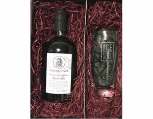 70cl of bottle Foxdenton Sloe Gin in a gift box with an Ice and a Slice Branded Hiball glass, surrounded by burgundy shredded paper in a black magnetic gift box