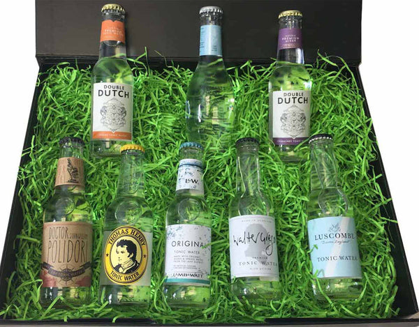 Black magnetic gift box with a total of 16 craft tonic waters, presented on green shred