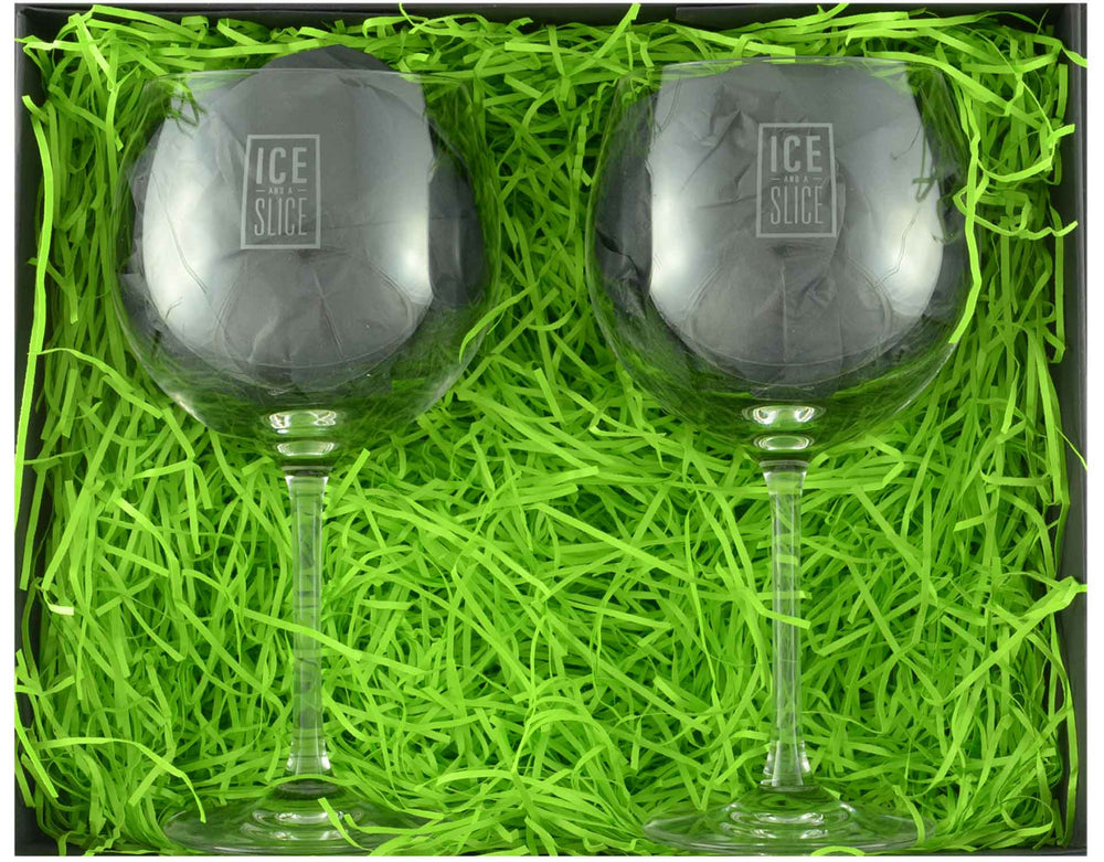 Pair of Dartington Crystal Gin and Tonic Balloon Glasses presented in a black magnetic gift box with zesty green shred