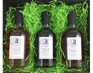 Black magnetic gift box containing green shred and 35cl Sloe Gin, Winslow Plum Gin and Rhubarb Gin from Foxdenton Estate