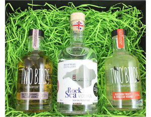 Black magnetic box with green shred containing a 20cl bottle of Two Birds Salted Carmel Vodka, 35cl bottle of Rock Sea Vodka and 20cl bottle of Two Birds Passionfruit Vodka