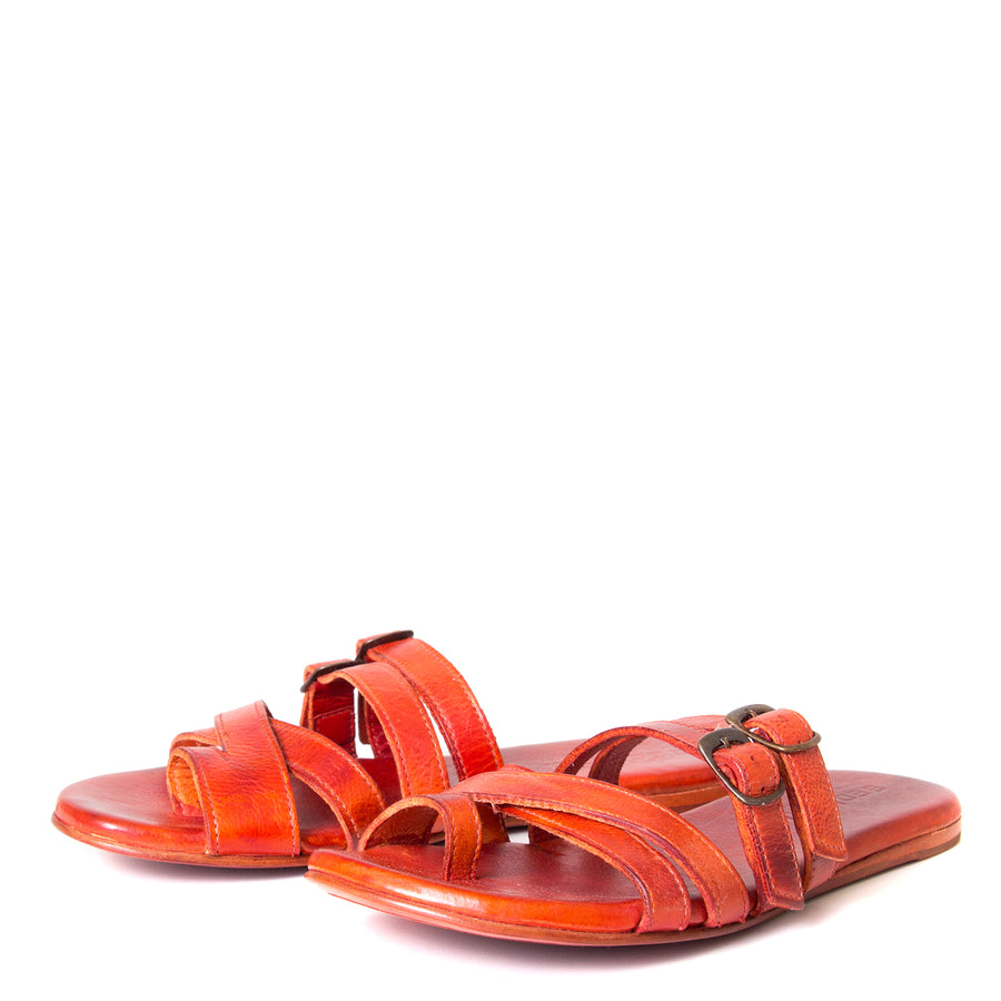 Bed Stu Hilda. Women's sandal, slide in orange red leather, toe ring and adjustable buckles. Front view, pair.
