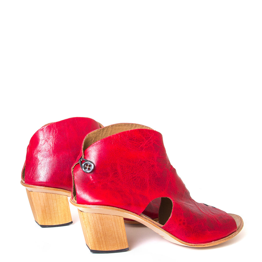 Cydwoq Research Women's sandal in Red washed leather, 2.5 inch wooden Heel, open toe, made in California. Back view, pair.