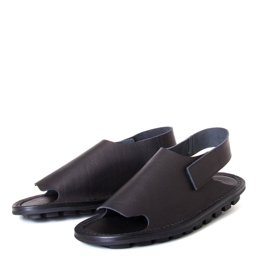 Trippen Clinch. Men's sandal, Soft Black leather upper, velcro strap around heel, flexible rubber sole. Made in Germany. Side view, pair.