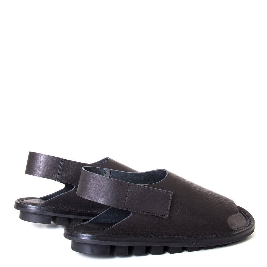Trippen Clinch. Men's sandal, Soft Black leather upper, velcro strap around heel, flexible rubber sole. Made in Germany. Back view, pair.