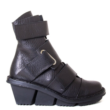 Trippen Secure. Women's Black leather wedge ankle boot with 3 velcro straps, 2-inch rubber heel. Side view.