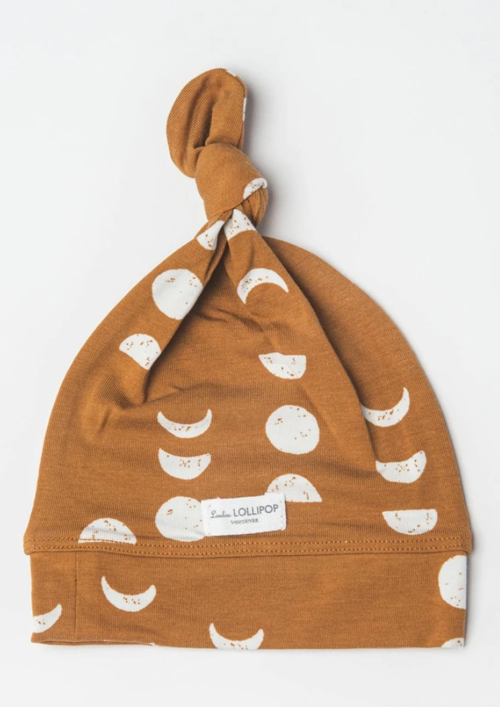 loulou lollipop top knot beanie in moon