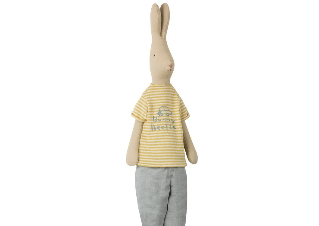 Meet our Mega rabbit, Sam! He is very handsome and loves being around friends. Sam is wearing a yellow striped t-shirt and grey pants.