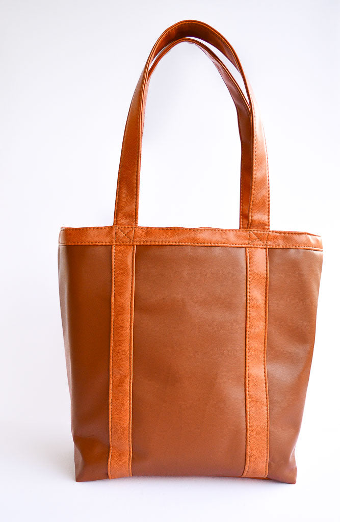 b7efdf42c4d1 The whiskey tote features the vegan leather in the whiskey and promessa®  colors.