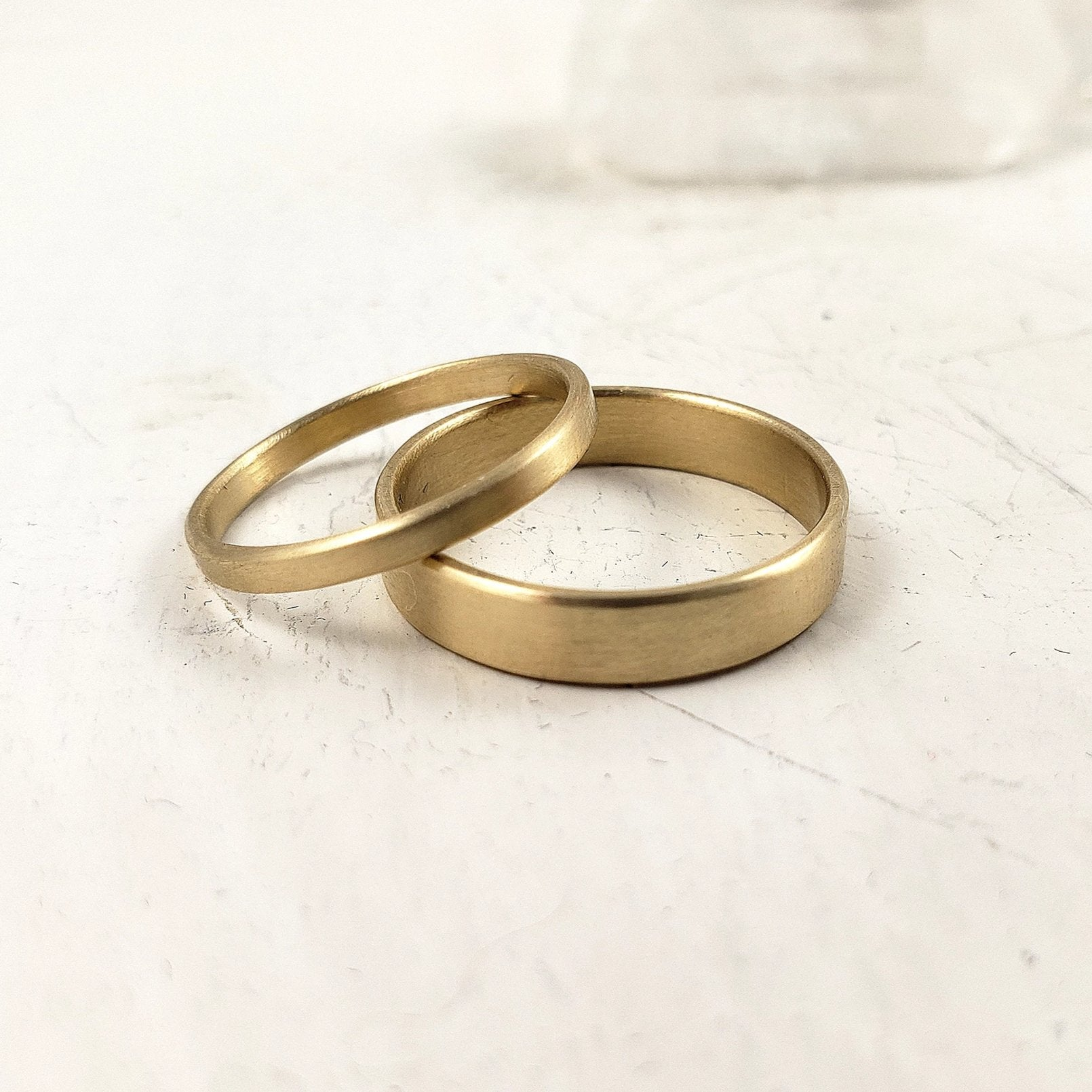 Set of solid gold wedding bands, 10k, 14k and 18 k yellow gold
