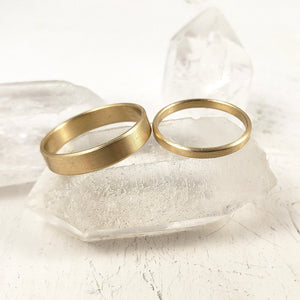 His and Hers classic wedding band set in solid yellow gold.