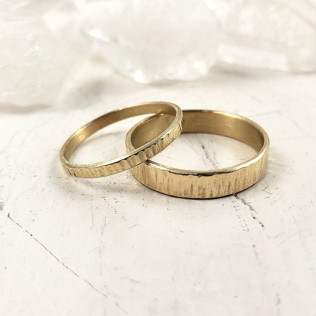 Set of solid gold engagement bands, textured and handmade in Canada