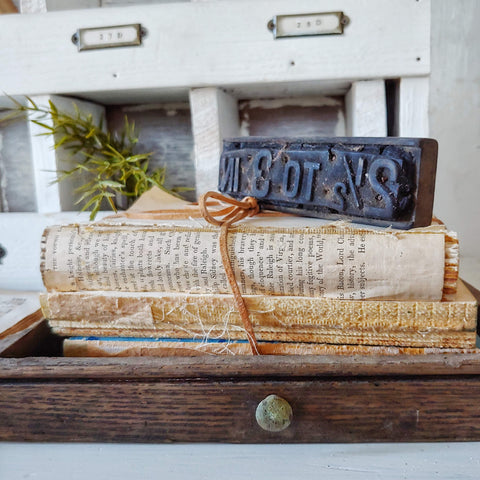 vintage books displayed beautifully on a wood tray