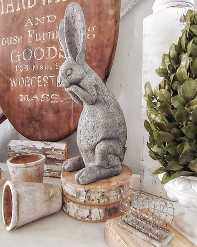 concrete bunny on vintage buffet spring decor