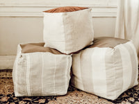 Striped linen square poufs