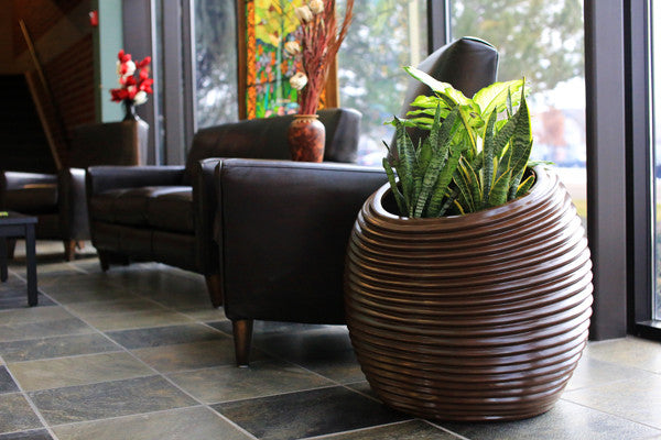 Fiberglass, Metal, or Resin: How To Choose The Right Planter Material For Any Design or Landscape