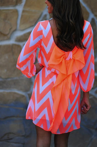 orange and pink chevron bow back dress