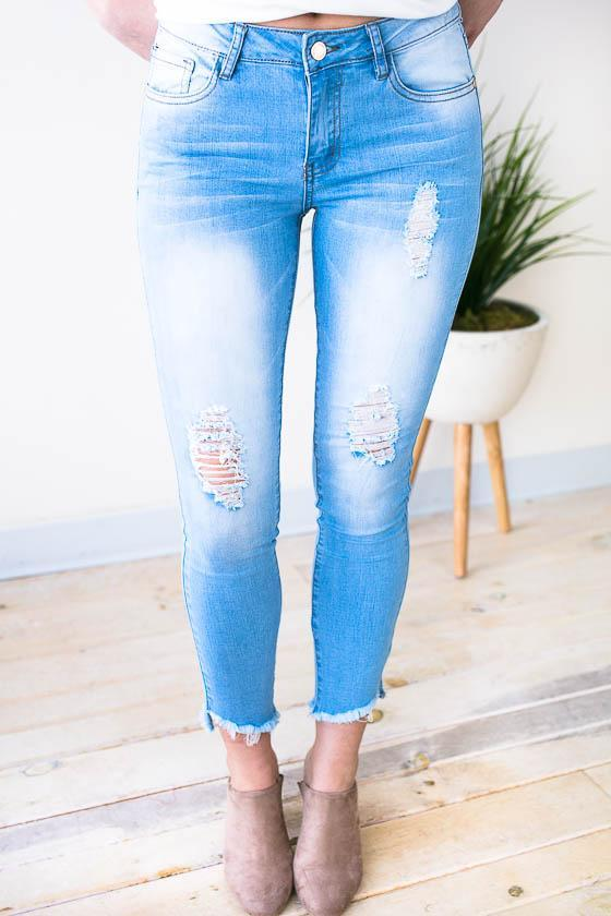 Bottoms Torn Up Asymmetric Hem Skinny Jeans - Lotus Boutique